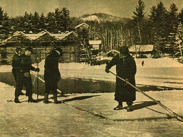 A group harvesting a raft of ice on Moody Pond in Saranac Lake