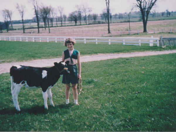 Marilyn Thompson training a calf for the 4-H in Lisbon