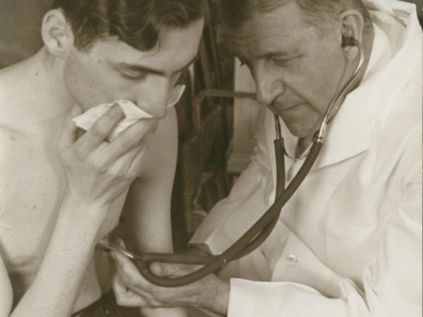 Dr. Trudeau examining a tuberculosis patient in Saranac Lake
