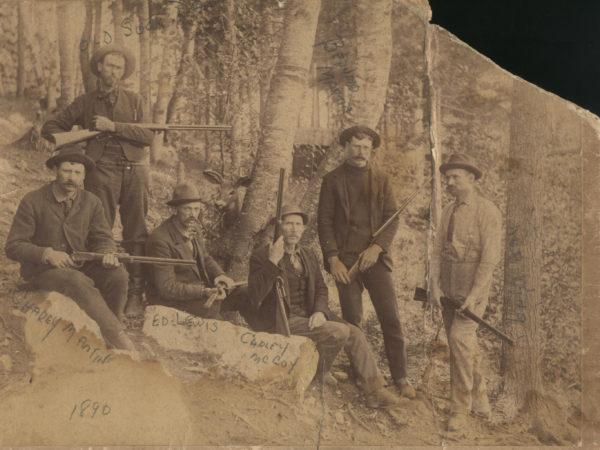 Adirondack guides posed outside Saranac Lake