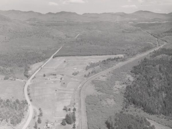 An aerial view of the railroad tracks between Lake Placid and Saranac Lake. Date unknown. Lake Placid and Saranac Lake, NY. Courtesy of the Saranac Lake Free Library.