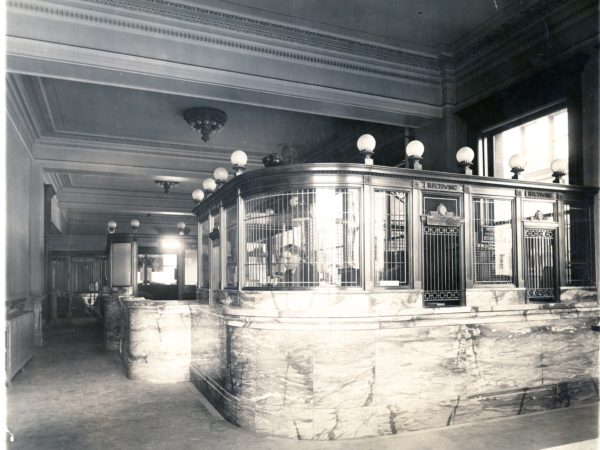 A teller inside the Jefferson County National Bank in Watertown