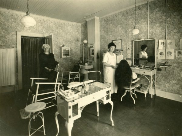 Hairdresser and customer at the Madam Gernnades Beauty Parlor in Watertown
