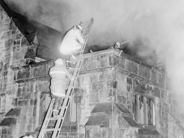 Fighting a fire on top of the All Souls Universalist Church in Watertown