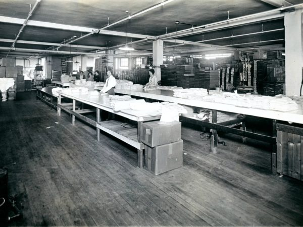 Folding shirts inside the Geo Sweetser & Son Shirt Factory in Watertown