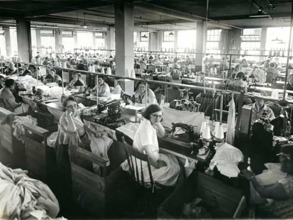 A room full of workers at the Geo Sweetser & Son Shirt Factory in Watertown