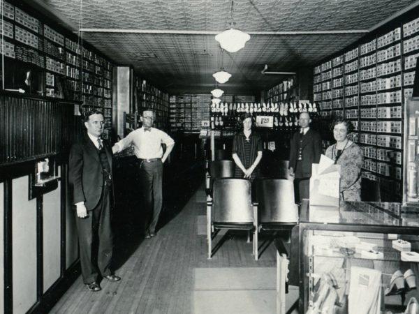 Employees inside G.R. Kinney Company Shoes in Watertown