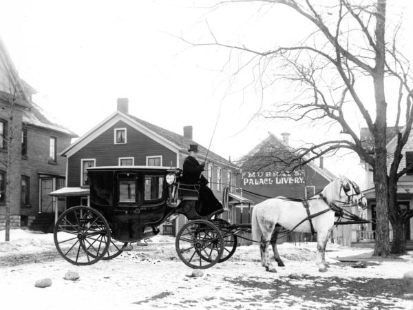 Horse-drawn carriage at Murray's Palace Livery in Watertown