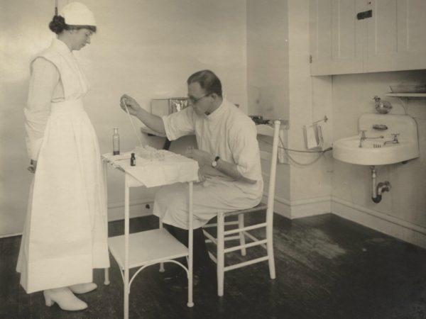 A doctor and nurse in a Trudeau Sanatorium lab in Saranac Lake