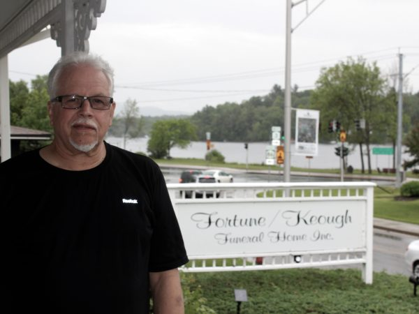 Andrew Fortune in front of the Fortune/Keough Funeral Home in Saranac Lake
