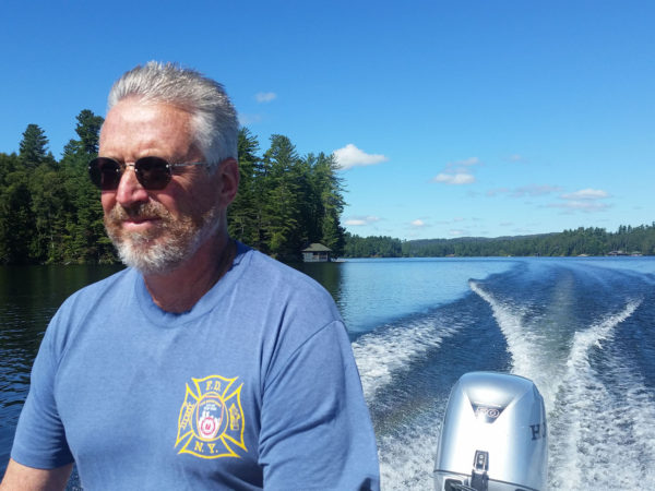 Caretaker Pete McConville driving on Upper Saint Regis Lake