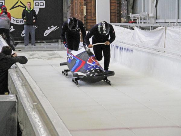 Olympic bobsledders at the Mount Van Hoevenberg sliding track in Lake Placid