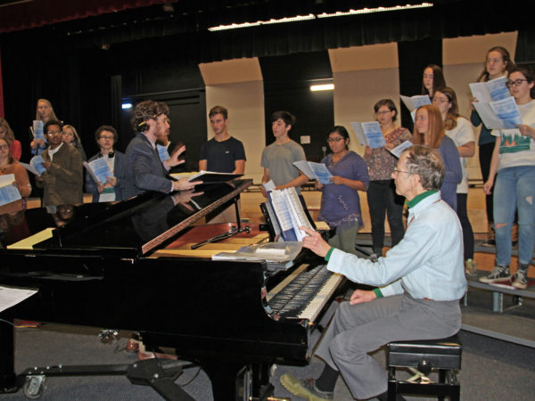 Drew Benware and accompanist Tom Delahant working with students in Saranac Lake