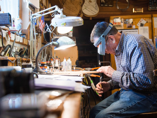 David Nichols crafting a custom guitar in Malone
