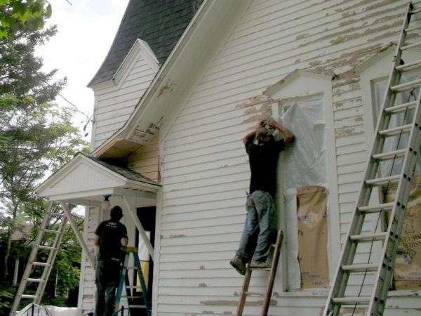 Repairing the siding of the Wanakena Presbyterian Church
