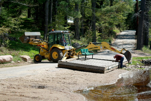 Moving the Wanakena Town dock back into the Oswegatchie River