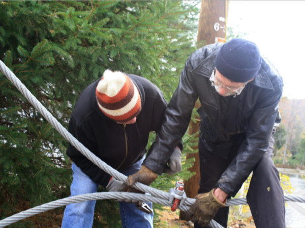 Stringing cable for the footbridge in Wanakena