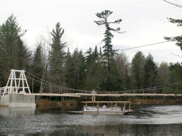 Hauling lumber for the Wanakena footbridge with a pontoon boat