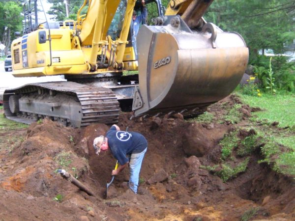 Digging a hole to anchor the cables for the Wanakena footbridge