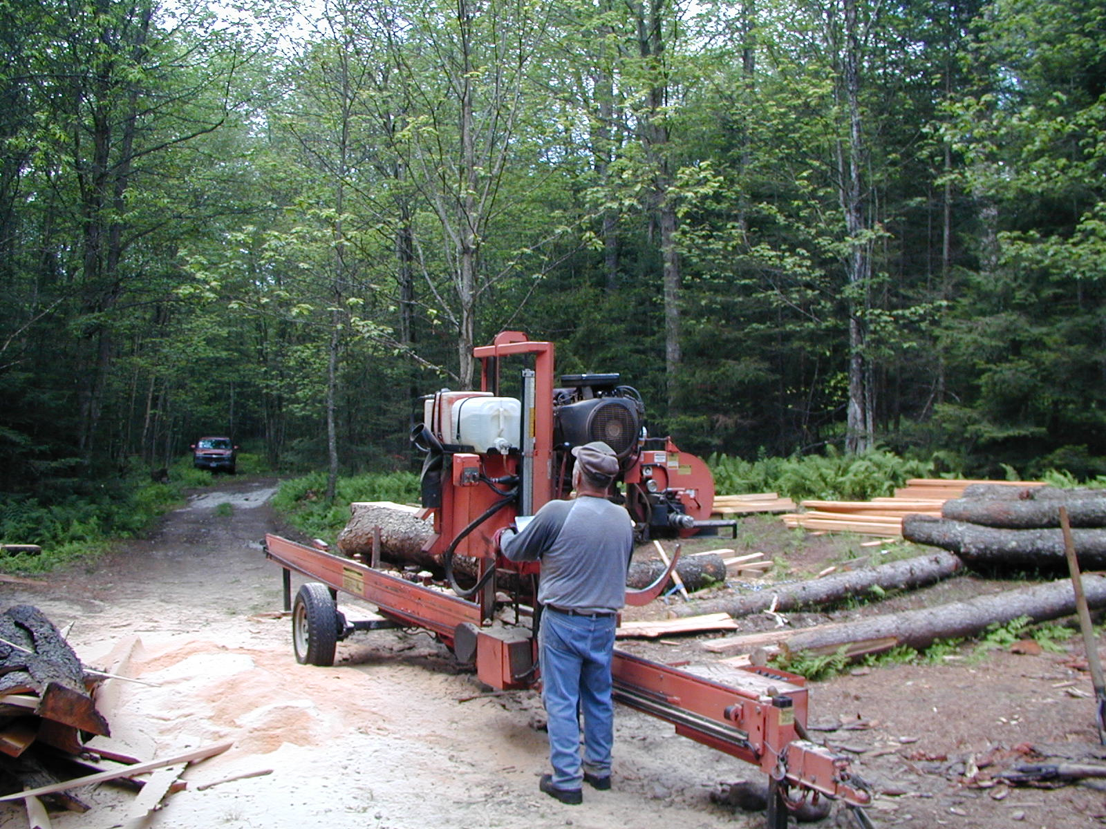 A sawyer using a portable sawmill in Colton |