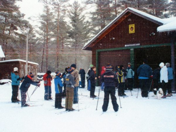 Volunteer ski instructors with ski students at Higley Flow State Park in Colton