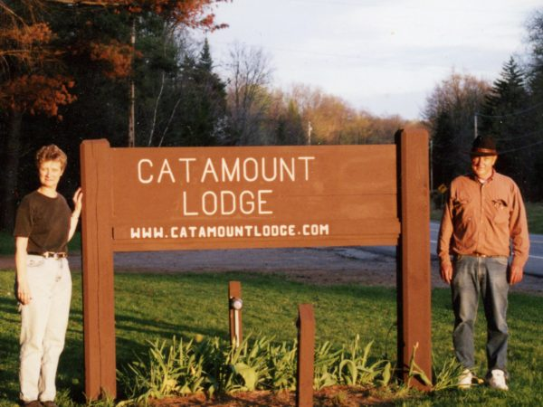 Catamount Lodge owners with the property sign in Colton