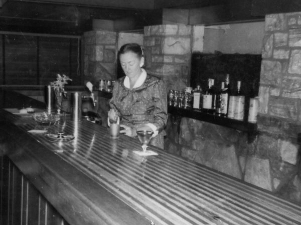 Ann O'Brien Martin bartending at Catamount Lodge in Colton