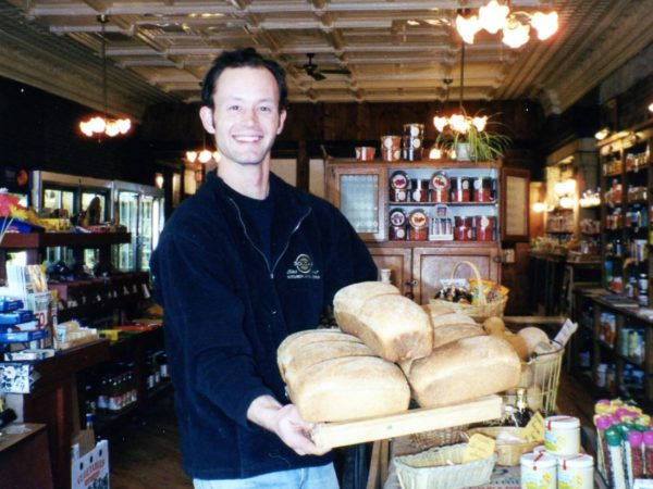 A Nature's Storehouse employee with freshly baked bread in Canton