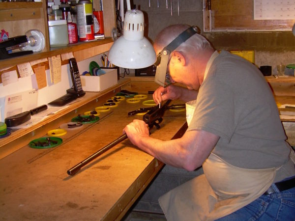 Brian MacDougall in his gunsmith shop in Colton