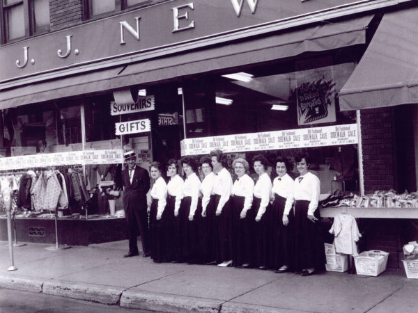 Employees in front of the J.J. Newberry department store in Tupper Lake