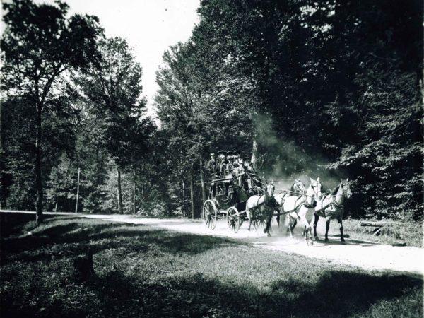 Stagecoach driving to the Saranac Inn on Upper Saranac Lake