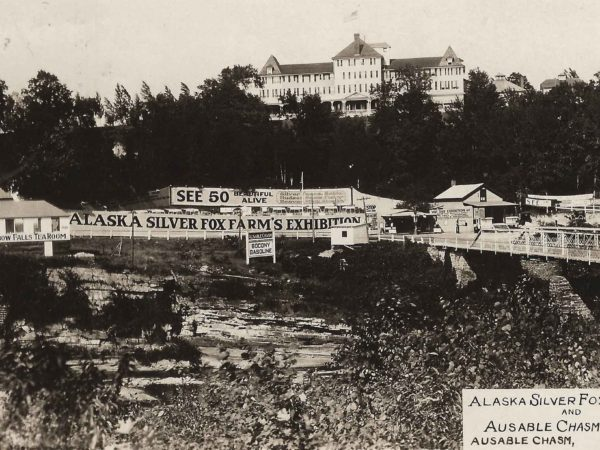 Exterior of the Alaska Silver Fox Farms with the Ausable Chasm Hotel in background