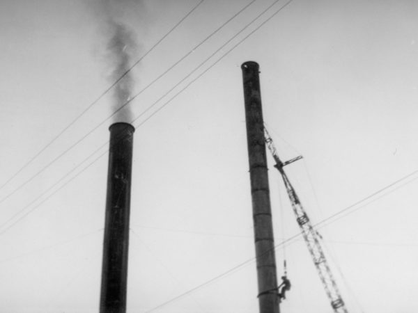 Worker atop a smokestack at a coal plant in Plattsburgh