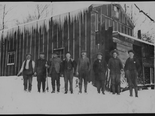 Workers outside a logging camp in Tupper Lake