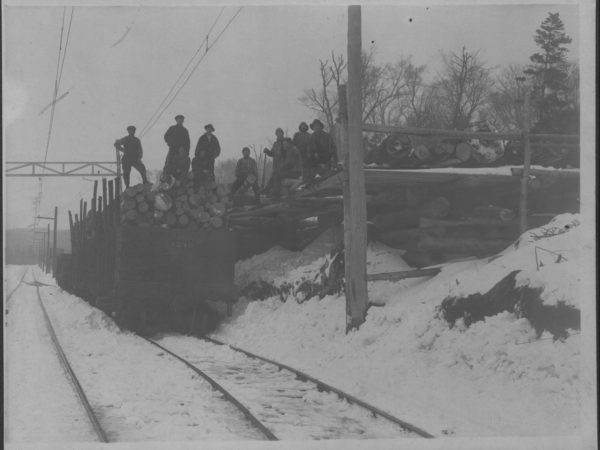 Loading a train car with logs in Tupper Lake