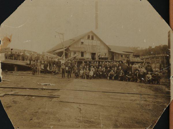Workers outside a sawmill in Tupper Lake