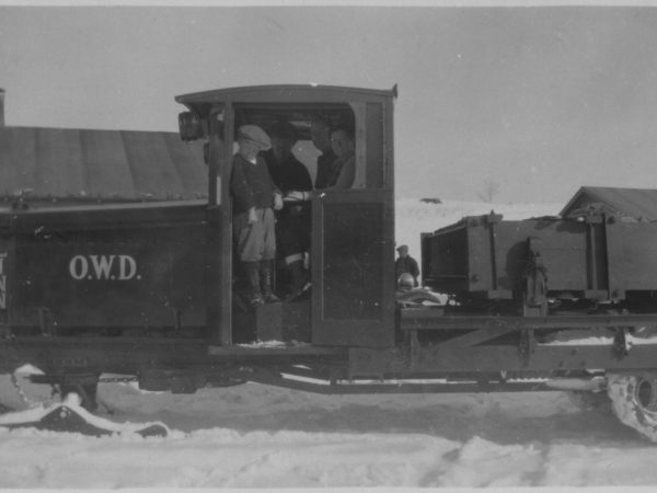 People posing on a Linn tractor in Tupper Lake