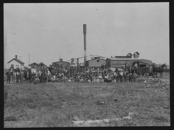 Workers posed outside the Brooklyn Cooperage Plant in Tupper Lake