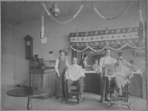 Two barbers at work in Tupper Lake