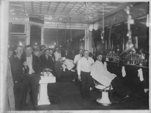 A crowded barbershop in Tupper Lake
