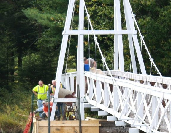 Repairing the cement footings of the old Wanakena footbridge