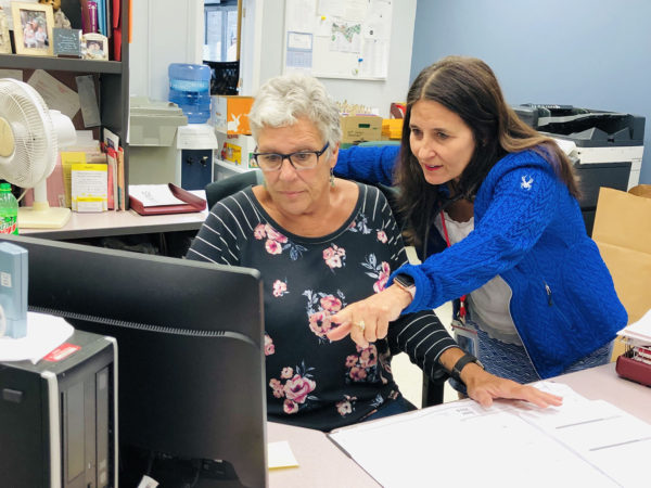 Dr. Kathleen Camelo Speaks with one of her staff in Plattsburgh