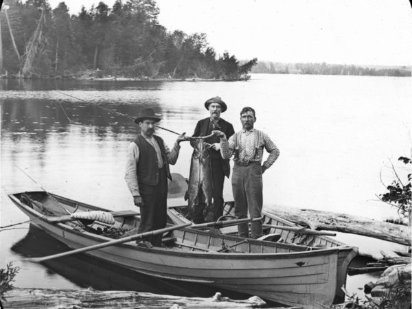Three fishing guides with a catch in Alexandria Bay
