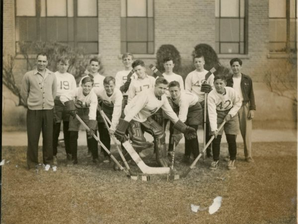 Coach George Brown with his first hockey team in Alexandria Bay