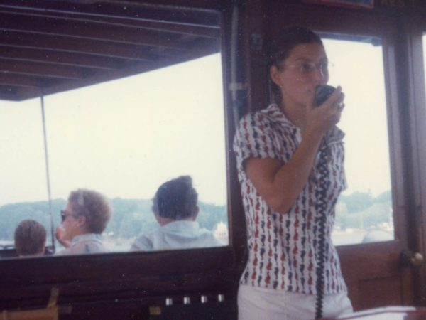 Barbara Brown announcing on a boat tour in Alexandria Bay