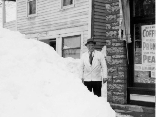 Giles Wallace outside the Red & White Store in Alexandria Bay