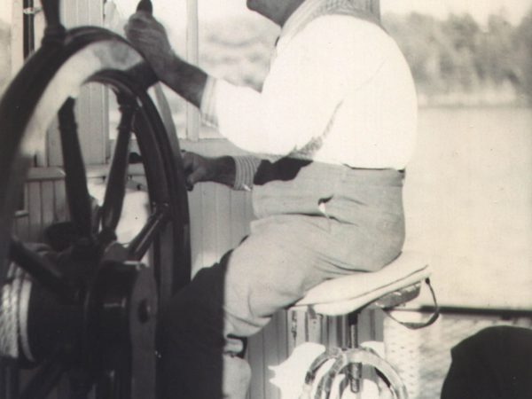 Captain at the helm of a ferry in Alexandria Bay