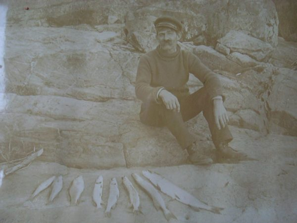 Fishing guide with his catch in Alexandria Bay