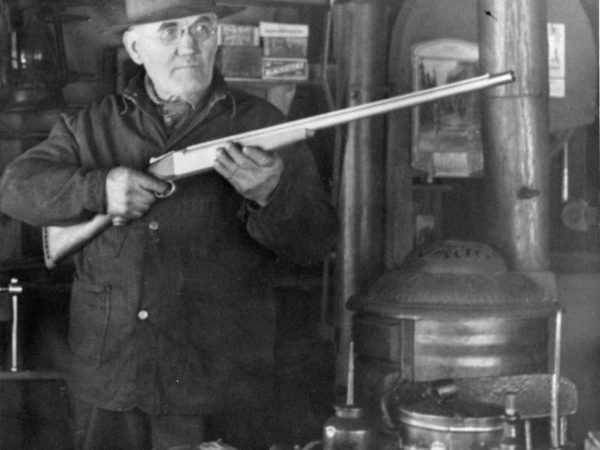 Working with a rifle inside Cranker Machine Shop in Alexandria Bay