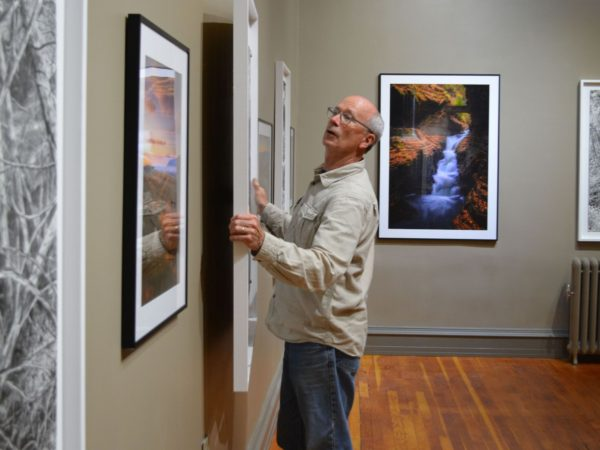 Artist Dan Keegan mounting a drawing in Elizabethtown